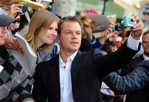 """Actor Matt Damon arrives at the world premiere of """"Elysium"""" at the Regency Village Theater on Wednesday, Aug. 7, 2013 in Los Angeles. (Photo by Jordan Strauss/Invision/AP)"""