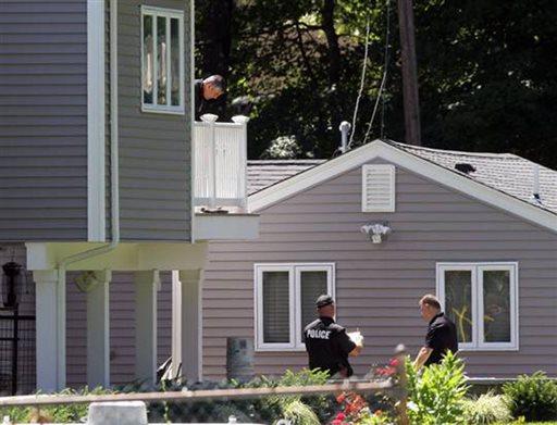 Investigators work the scene of a double homicide Sunday Aug. 11, 2013 in Johnston, RI.