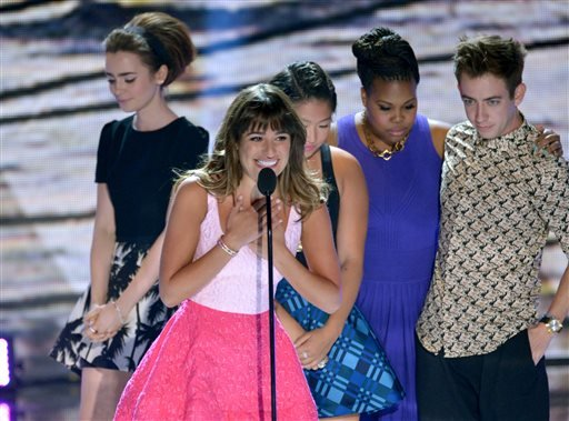 """Actress Lea Michele, center, from """"Glee""""speaks on stage as she accepts an award at the Teen Choice Awards at the Gibson Amphitheater on Sunday, Aug. 11, 2013, in Los Angeles."""
