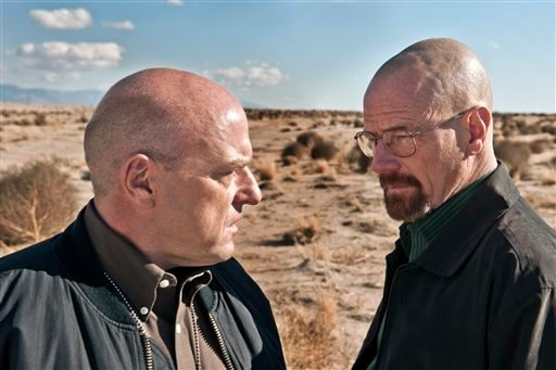 "This publicity image released by AMC shows Dean Norris as Hank Schrader, left, and Bryan Cranston as Walter White in ""Breaking Bad."""
