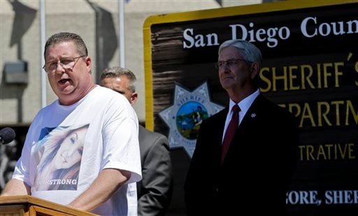 Brett Anderson, wearing a shirt featuring a photo of his daughter, Hannah, makes a statement regarding her kidnapping and rescue at a news conference Monday, Aug. 12, 2013, in San Diego.