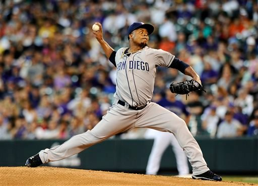 San Diego Padres starting pitcher Edinson Volquez throws in the first inning of a baseball game against the Colorado Rockies on Monday, Aug. 12, 2013 in Denver. (AP Photo/Chris Schneider)