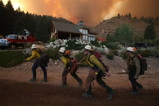 Hundreds of firefighters, including the Ironwood Hotshots from Tucson, Ariz., gathered Sunday to battle the 80,300-acre Elk Fire Complex burning across Elmore County, Idaho, on Sunday, August 11, 2013.
