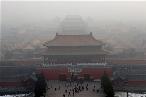 In this Jan. 13, 2013 file photo, visitors gather near an entrance to the Forbidden city during a very hazy day in Beijing.