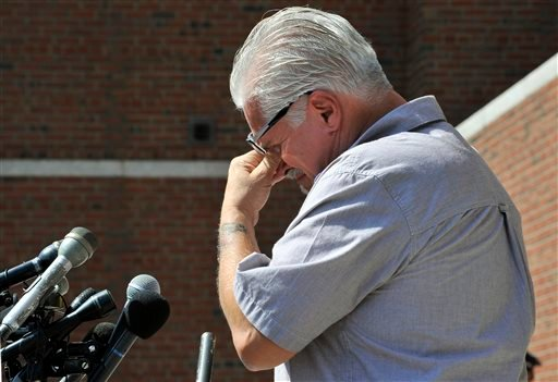 "Steven Davis, brother of Debra Davis, wipes his eyes while speaking outside federal court where a jury found James ""Whitey"" Bulger guilty on several counts of murder, racketeering and conspiracy Monday, Aug. 12, 2013 in Boston."