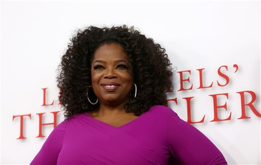 """Oprah Winfrey arrives at the Los Angeles premiere of """"Lee Daniels' The Butler"""" at the Regal Cinemas L.A. Live Stadium 14 on Monday, Aug. 12, 2013. (Photo by Matt Sayles/Invision/AP)"""