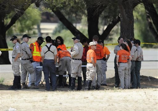 Members of search and rescue teams from multiple counties gather in Lagoon Valley Park in Vacaville, California as they await their assignments during an ongoing search for Sandra Coke, 50 of Oakland on Friday, Aug. 9, 2013. (AP)