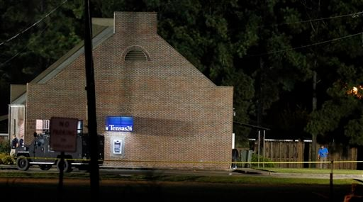 Investigators work throughout the early morning hours Wednesday, Aug. 14, 2013 at the Tensas State Bank branch in St. Joseph, La., where a gunman took three people hostage Tuesday. (AP Photo/Rogelio V. Solis)