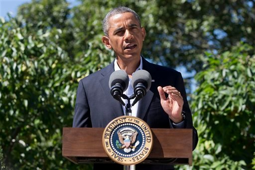 President Barack Obama makes a statement to the media regarding events in Egypt, from his rental vacation home in Chilmark Mass., on the island of Martha's Vineyard, Thursday, Aug. 15, 2013. (AP Photo/Jacquelyn Martin)