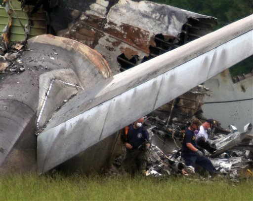 National Transportation Safety Board investigators remove a black box from the the tail section of the UPS cargo plane that crashed Wednesday on approach to the Birmingham-Shuttlesworth International Airport Thursday, Aug. 15, 2013 in Birmingham, Ala.(AP)