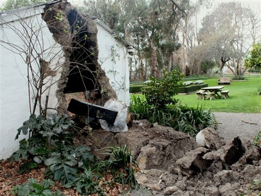 A part of house wall was damaged in the small South Island town of Seddon after a magnitude-6.5 earthquake hit in the upper South Island of New Zealand, Friday, Aug. 16, 2013.