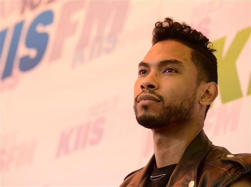In this May 11, 2013 file photo, singer Miguel arrives at Wango Tango 2013 at The Home Depot Center in Carson, Calif.