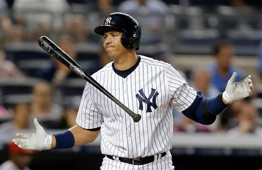 New York Yankees' Alex Rodriguez reacts after striking out in the seventh inning of a baseball game against the Los Angeles Angels, Tuesday, Aug. 13, 2013, in New York. (AP Photo/Kathy Willens)