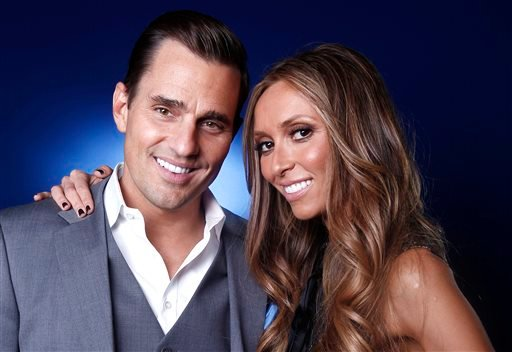 This April 2, 2012 file photo shows TV personality and businessman Bill Rancic in New York. Rancic embraces the notion of being part of a power couple with wife Giuliana.