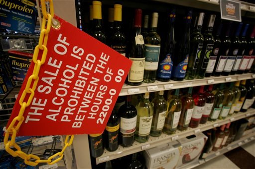 A sign prohibiting the sale of alcohol between certain hours is seen in the aisle at the Naval Station Norfolk Main Exchange, Wednesday, July 31, 2013 in Norfolk, Va. The NEX Main Exchange is the world's largest among military installations.