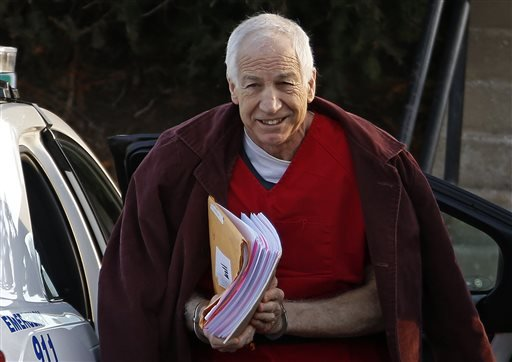 In this Jan. 10, 2013, file photo, former Penn State assistant football coach Jerry Sandusky arrives at the Centre County Courthouse for a post-sentencing hearing in Bellefonte, Pa.