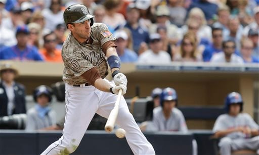 San Diego Padres' Chris Denorfia gets an infield hit to drive in the tying run against the New York Mets in the eighth inning of a baseball game on Sunday, Aug. 18, 2013, in San Diego. (AP Photo/Lenny Ignelzi)