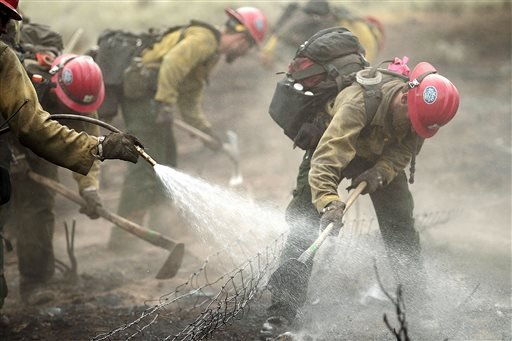 Members of the Prescott Hotshots mop up part of the Beaver Creek Fire on Saturday, Aug. 17, 2013 west of Hailey, Idaho.(AP Photo/Times-News, Ashley Smith)
