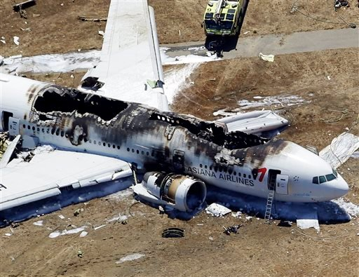 In this July 6, 2013 file aerial photo shows the wreckage of the Asiana Flight 214 airplane after it crashed at the San Francisco International Airport in San Francisco.