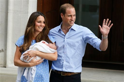 In this July 23, 2013 photo, Britain's Prince William, right, and Kate, Duchess of Cambridge, hold the Prince of Cambridge, as they pose for photographers outside St. Mary's Hospital exclusive Lindo Wing in London where the Duchess gave birth on July 22.