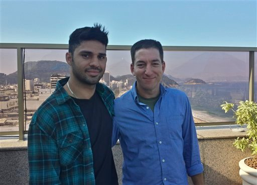 In this undated photo released by Janine Gibson of The Guardian, Guardian journalist Glenn Greenwald, right, and his partner David Miranda, are shown together at an unknown location.