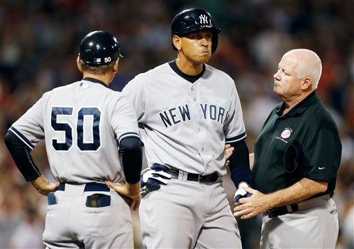 FILE - In this Aug. 18, 2013 file photo, New York Yankees' Alex Rodriguez, center, is tended to by a trainer at first base after being hit by a pitch in the second inning of a baseball game against the Boston Red Sox in Boston. (AP)