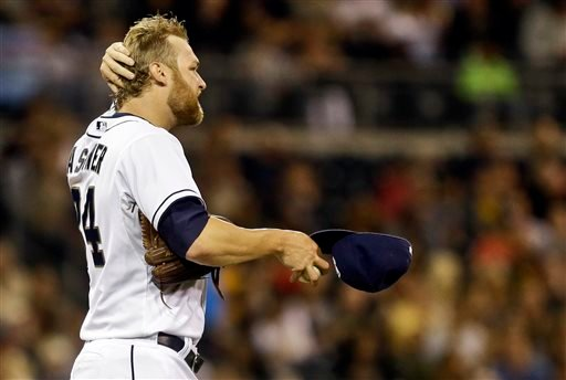 San Diego Padres starting pitcher Andrew Cashner gathers himself after surrendering a solo home run to Pittsburgh Pirates' Pedro Alvarez in the sixth inning of a baseball game, Monday, Aug. 19, 2013, in San Diego. (AP Photo/Lenny Ignelzi)