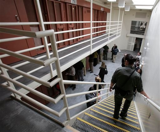 In this Aug. 17, 2011 file photo, reporters inspect one of the two-tiered cell pods in the Secure Housing Unit at the Pelican Bay State Prison near Crescent City, Calif.