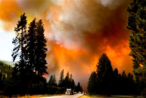 In this Monday, Aug. 19, 2013 photo, traffic on U.S. Highway 12 near Lolo, Mont., retreats to safety from the West Fork II fire that grew from less than 100 acres Monday morning to about 3,500 acres and burned both sides of the highway. (AP)