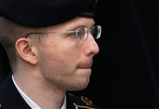 Army Pfc. Bradley Manning is escorted into a courthouse in Fort Meade, Md., Wednesday, Aug. 21, 2013, before a sentencing hearing in his court martial. (AP Photo/Patrick Semansky)