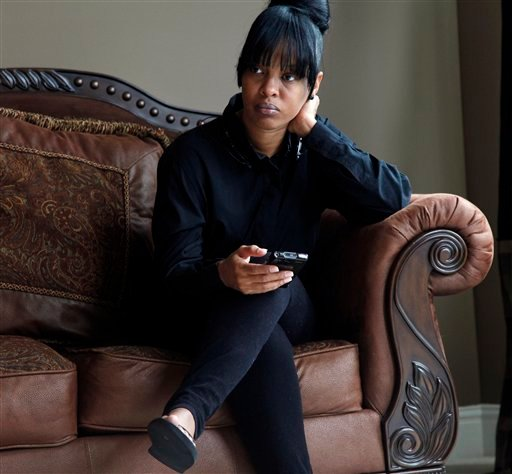 Natasha Knotts speaks to a reporter in Lithonia, Ga. on Wednesday, Aug. 21, 2013. Knotts told The Associated Press that Michael Brandon Hill lived with her and her husband for a time when he was in his late teens. (AP)