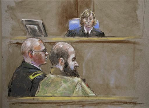 In this court room sketch, Judge Col. Tara Osborn, top, Maj. Nidal Malik Hasan, right, and defense attorney, Lt. Col. Kris Poppe, left, are shown, Wednesday, Aug. 21, 2013, in Fort Hood, Texas. (AP)