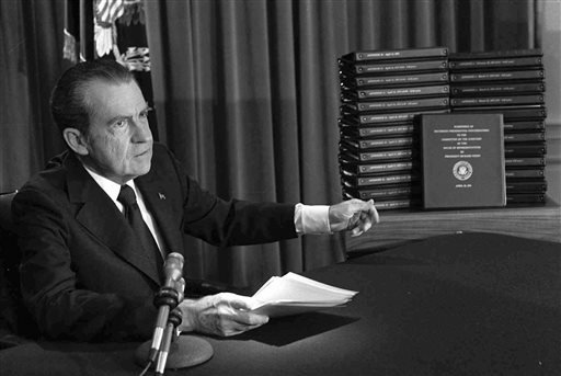 FILE - In this April 29, 1974, file photo, President Richard M. Nixon points to the transcripts of the White House tapes after he announced during a nationally-televised speech that he would turn over the transcripts to House impeachment investigators.