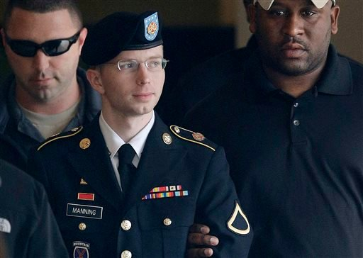 In this Tuesday, Aug. 20, 2013 file photo, Army Pfc. Bradley Manning is escorted to a security vehicle outside a courthouse in Fort Meade, Md., after a hearing in his court martial. (AP Photo/Patrick Semansky, File)