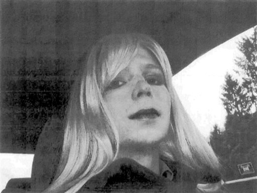 In this undated file photo provided by the U.S. Army, Pfc. Bradley Manning poses for a photo wearing a wig and lipstick. (AP Photo/U.S. Army, File)