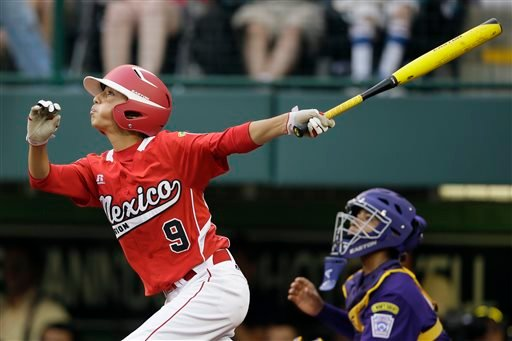 Tijuana, Mexico's Jorge Romero (9) follows through after hitting a two-run home run during the seventh inning of an elimination baseball game against Aguadulce, Panama, at the Little League World Series tournament on Thursday, Aug. 22, 2013.