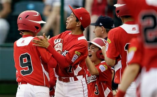 From left to right, Tijuana, Mexico's Jorge Romero, Martin Gonzalez and Jorge Duenas celebrate after Romero's two-run home run during the seventh inning of an elimination baseball game against Aguadulce, Panama.