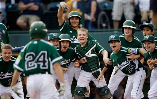 Westport, Conn., players wait to greet Chad Knight (24) after his home run off Sammamish, Wash.'s Jack Carper during the fifth inning of an elimination baseball game at the Little League World Series tournament.