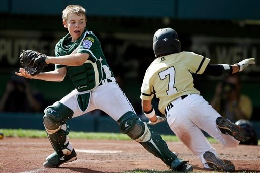 Sammamish, Wash.'s Dylan Matsuoka, right, scores past Westport, Conn.'s Matt Stone on an RBI-single by Jack Carper during the fourth inning of an elimination baseball game at the Little League World Series tournament.