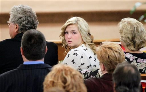 Hannah Anderson looks back into the crowd during the memorial service for her mother, Christina Anderson, and brother, Ethan Anderson at Guardian Angels Catholic Church on Saturday.