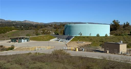 This Jan. 16, 2013 photo shows a five million gallon water storage tank and a building that houses a well, right, at Aquifer Storage and Recovery well field No. 2 in Moorpark, Calif.