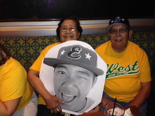 Nick Mora's grandmother holds up a picture of her favorite Eastlake All-Star Saturday.