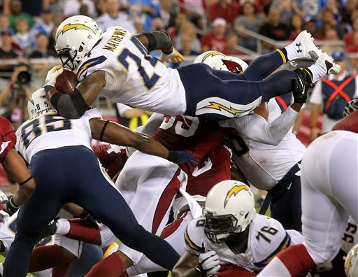 San Diego Chargers running back Ryan Mathews (24) dives into the end zone for a touchdown against the Arizona Cardinals during the first half of a preseason NFL football game, Saturday, Aug. 24, 2013, in Glendale, Ariz. (AP Photo/Rick Scuteri)