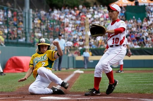 Tokyo, Japan, pitcher Kazuki Ishida (10) covers home as Chula Vista, Calif.'s Micah Pietila-Wiggs scores from third on a wild pitch in the first inning of the LLWS.
