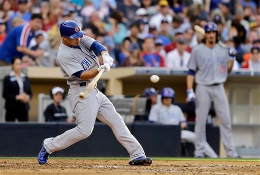 Chicago Cubs' Darwin Barney, left, connects for a solo home run in the fifth inning of a baseball game against the San Diego Padres, Saturday, Aug. 24, 2013, in San Diego. (AP Photo/Lenny Ignelzi)