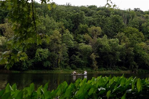 In this Wednesday, Aug. 7, 2013 photo, two men fish in a boat along the banks of the Schaghticoke Indian Reservation in Kent, Conn.