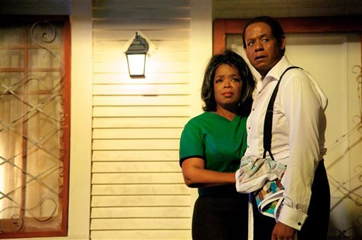 "This undated file film image provided by The Weinstein Company shows Oprah Winfrey as Gloria Gaines, left, and Forest Whitaker as Cecil Gaines in a scene from ""Lee Daniels' The Butler."""