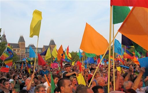 Some of more than 2,000 gay rights supporters protesting at Museum Square in Amsterdam, waving rainbow flags and chanting slogans criticizing the Russian government's homosexuality policies on Sunday, Aug. 25, 2013.