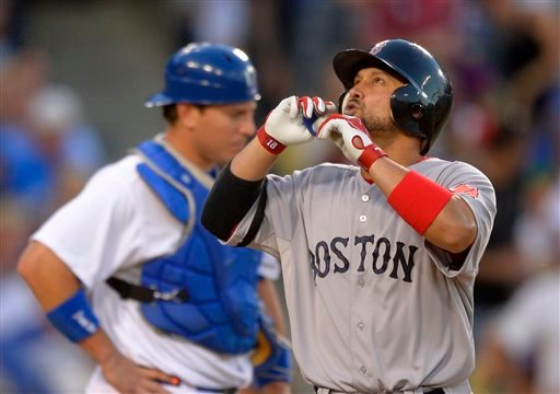 Boston Red Sox's Shane Victorino, right, points to the sky after hitting a solo home run as Los Angeles Dodgers catcher A.J. Ellis looks on during the seventh inning of their baseball game, Sunday, Aug. 25, 2013, in Los Angeles. (AP Photo/Mark J. Terrill)