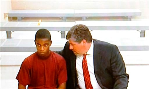 Demetrius Glenn, left, a teen that allegedly took part in the robbery and beating of 88-year-old World War II veteran Delbert Belton, listens to his lawyer, Christian J.